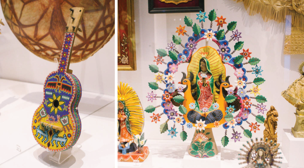 Handcrafted guitar and religious sculpture in the Museo de Arte Popular